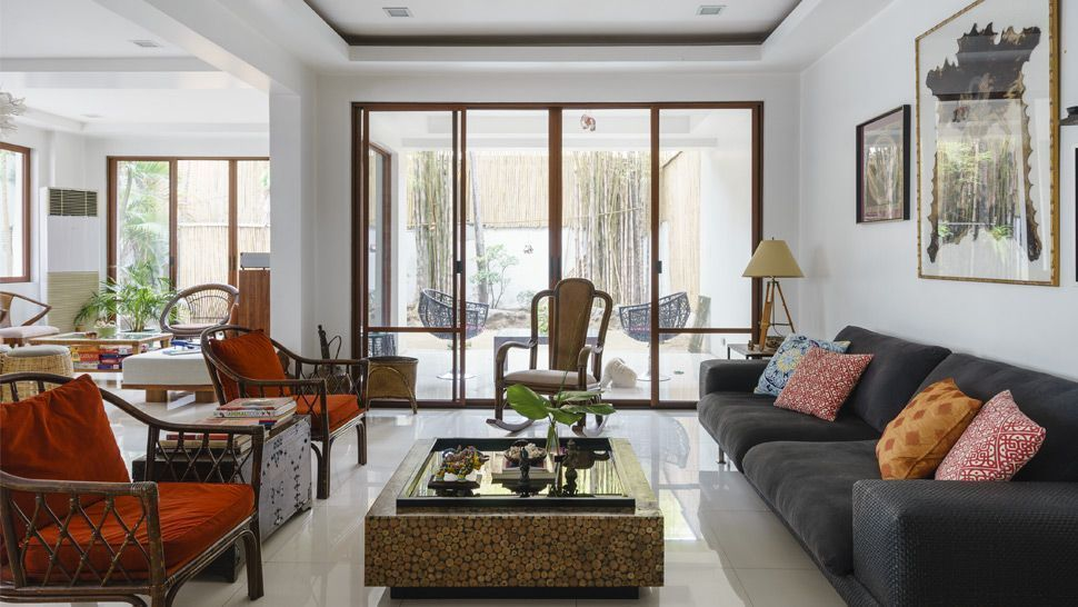 This Two Storey Home Showcases A Mix Of Traditional And Modern Filipino Pieces