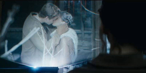 Liam Hemsworth as Gale Hawthorne and Jennifer Lawrence as Katniss Everdeen in Catching Fire