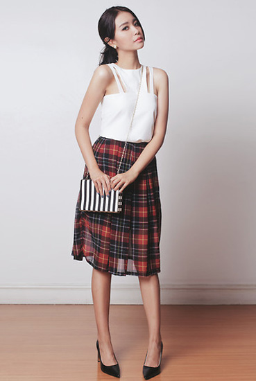 white crop and pleated skirt