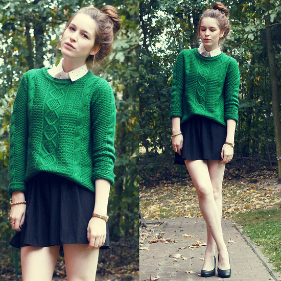 green sweater and black skirt