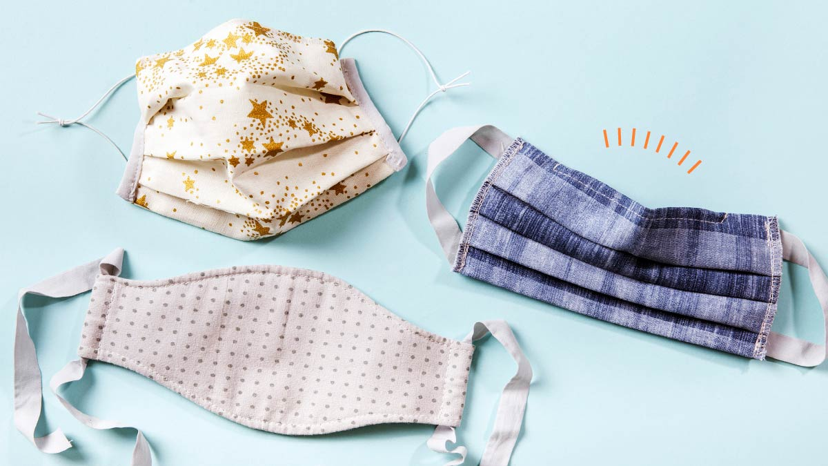 Three face masks with patterns: gold stars, stripes of blue denim, and plain black-and-white polka dots.