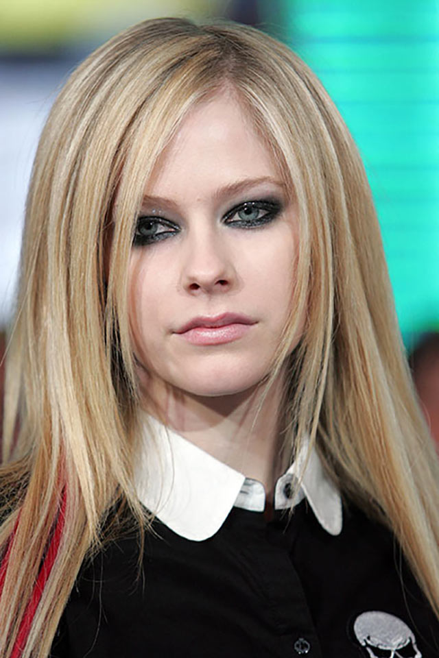 Avril Lavigne wearing her signature smoky eye makeup look.