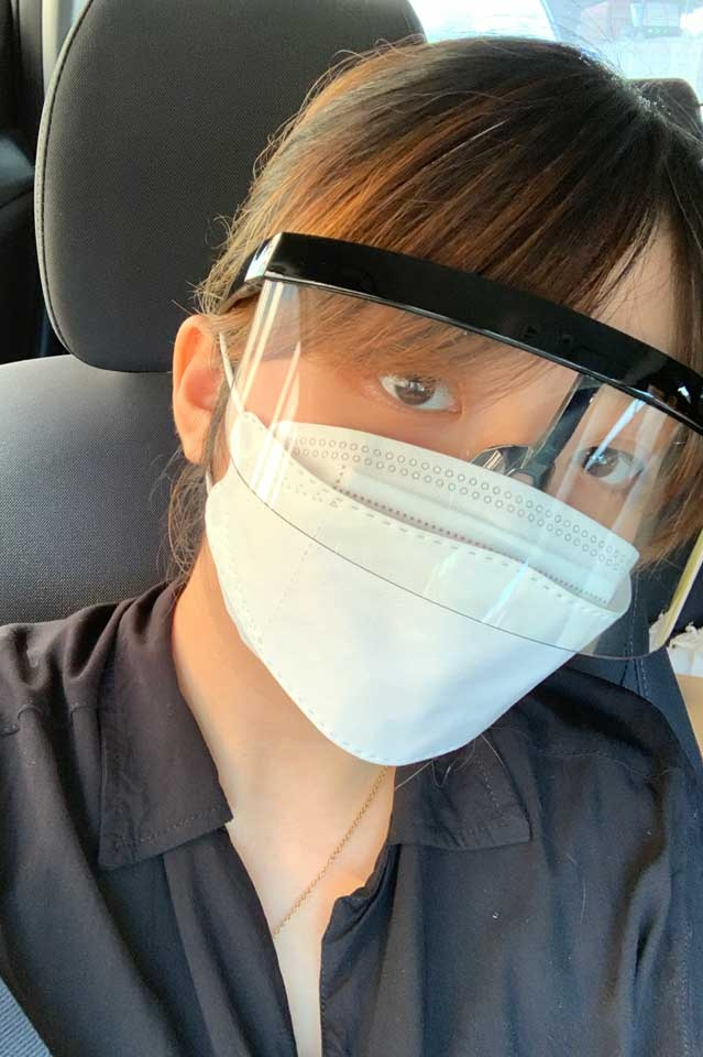 Wearing a face shield and face mask