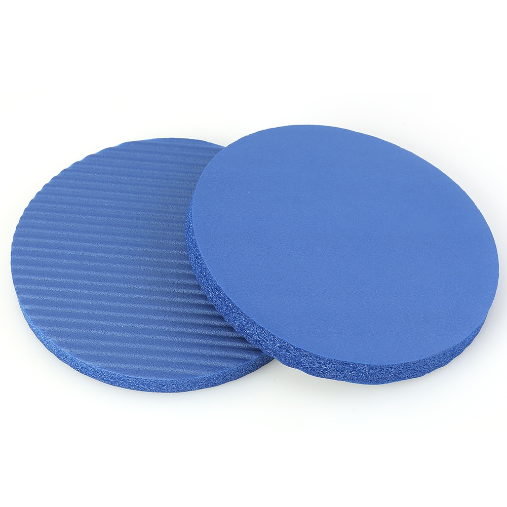 A pair of round exercise pads in blue