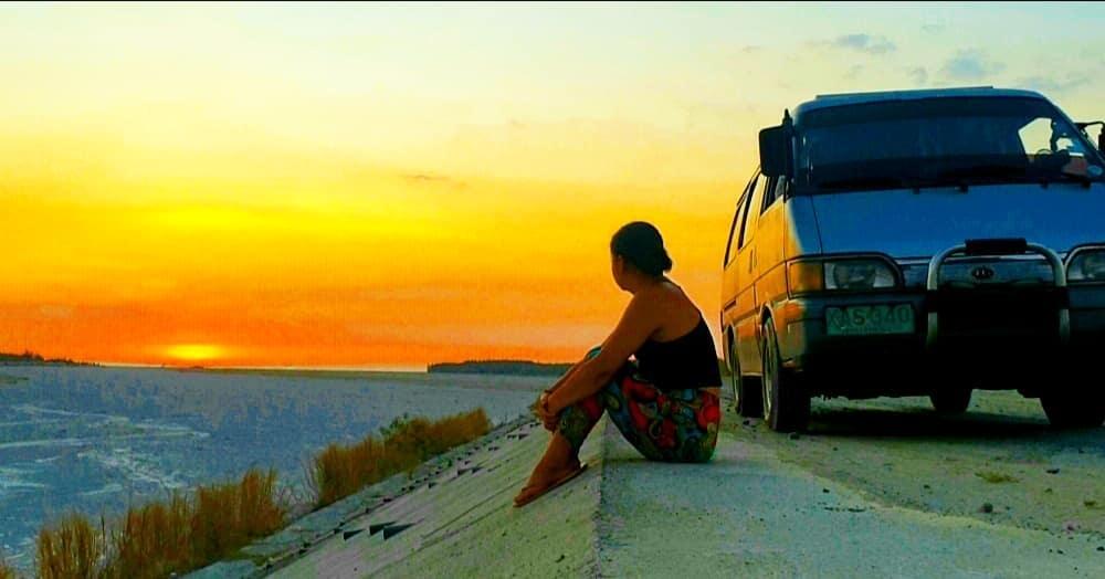 Pinay watching sunset, van life