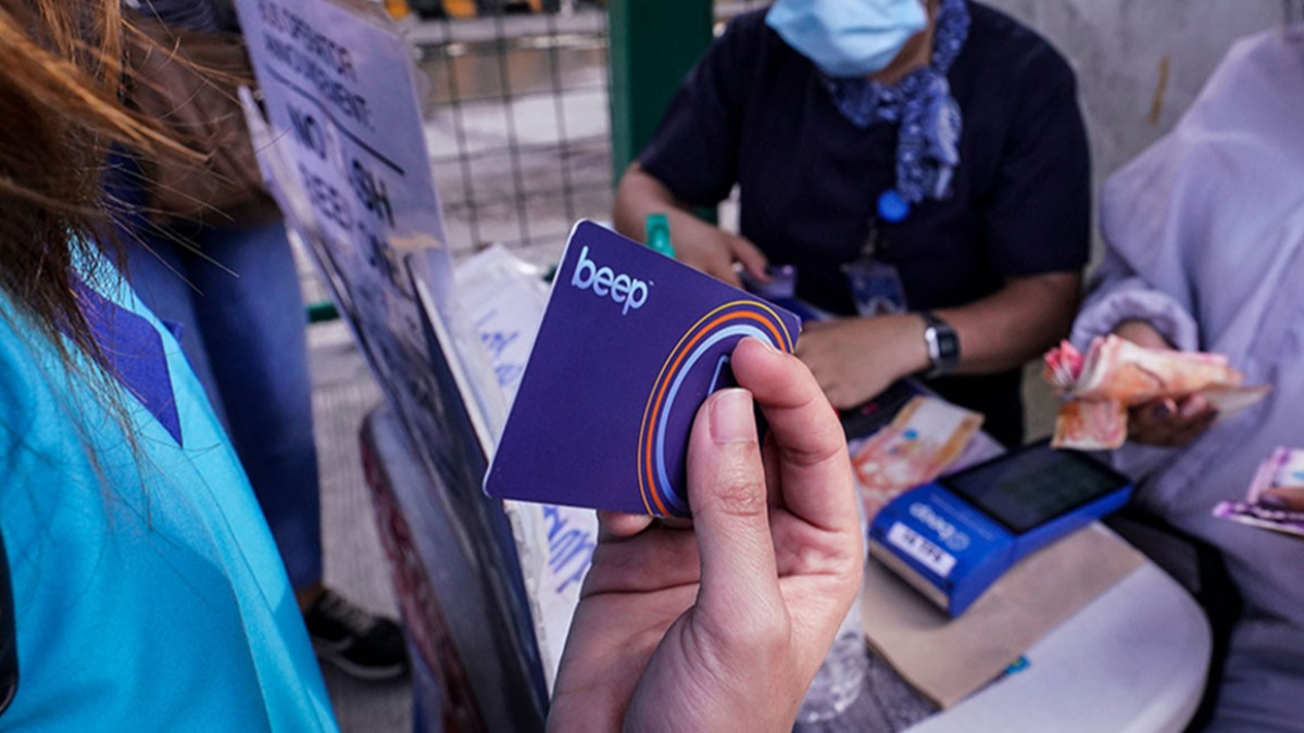 A shot of a woman holding a Beep card