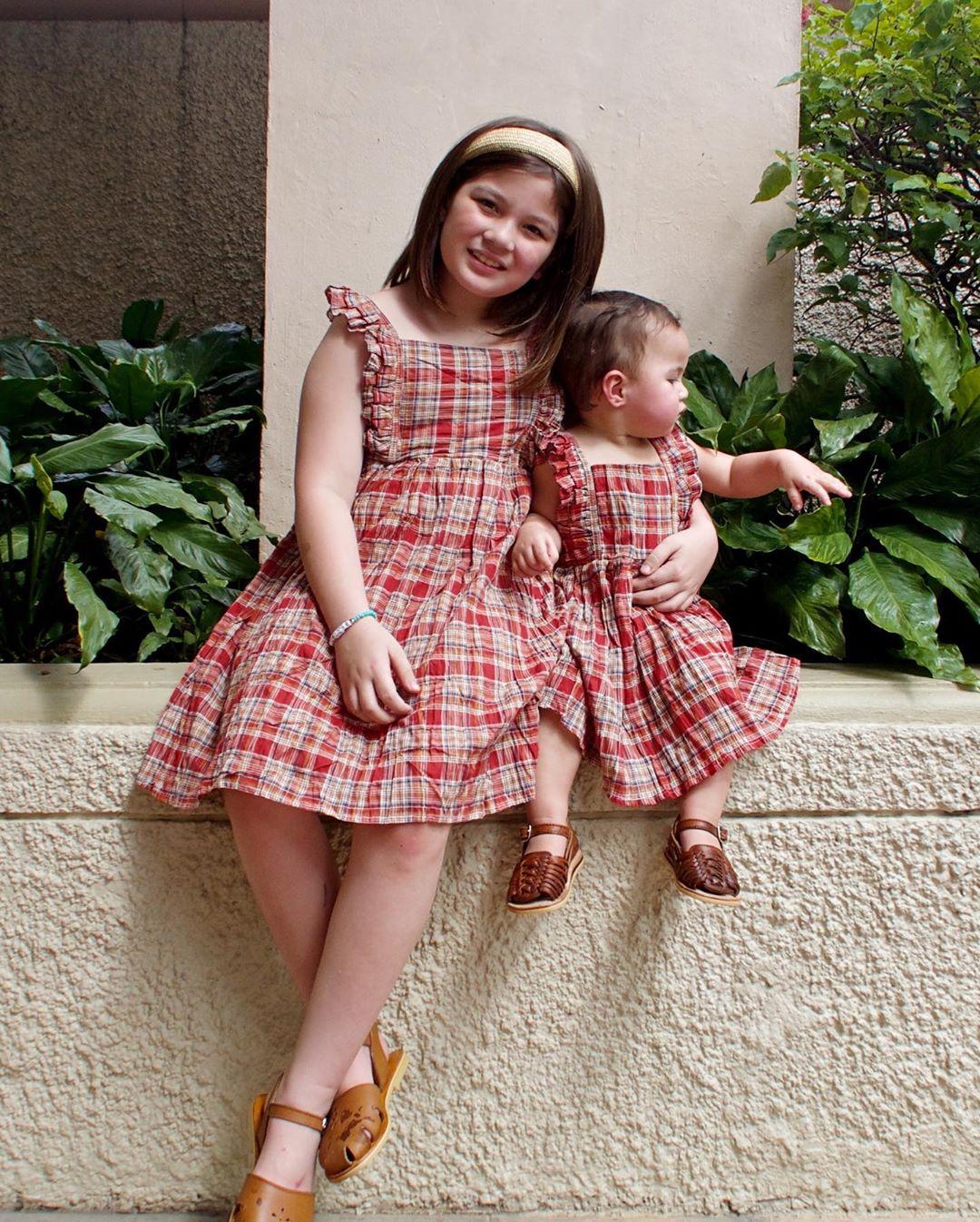 Sisters Ellie Eigenmann and Lilo Eigenmann-Alipayo in matching plaid outfits