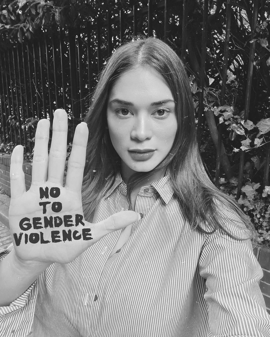 Pia Wurtzbach holding her hand up with the words NO TO GENDER VIOLENCE