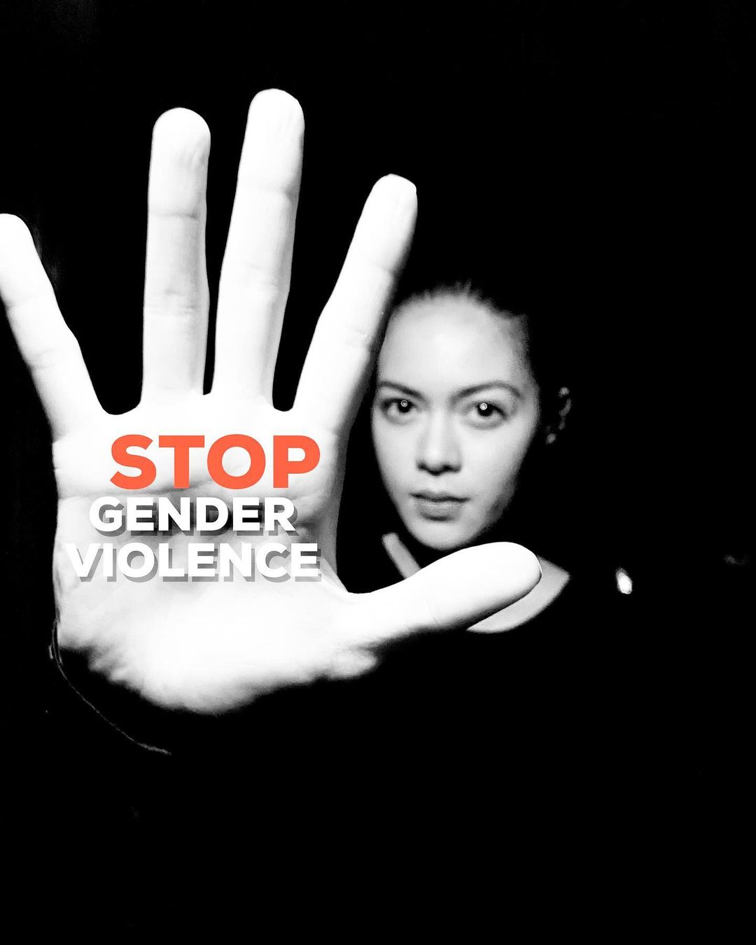 Shaina Magdayao holding her hand up with the words STOP GENDER VIOLENCE