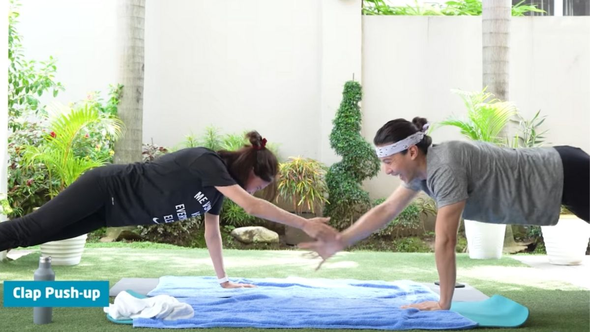 Enchong Dee and Erich Gonzales doing a couple workout