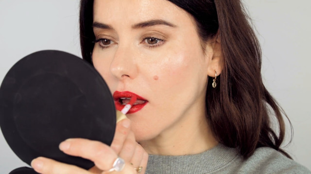 Apply lip gloss on the center of the lips