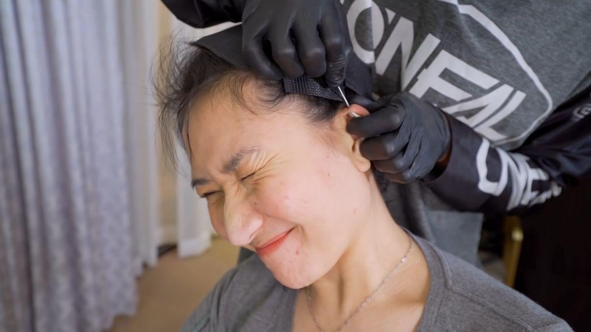 Chrysler Bernardo getting her ear pierced