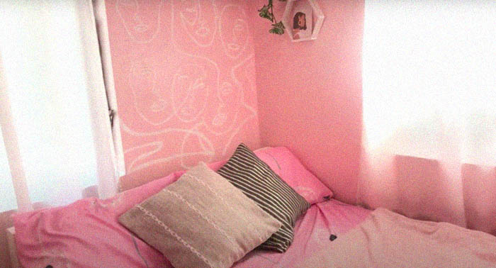 Low-budget room makeover: view of the bed