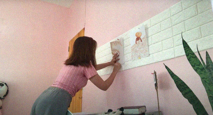 Low-budget room makeover: Christy Buen adding a 3D foam brick wall
