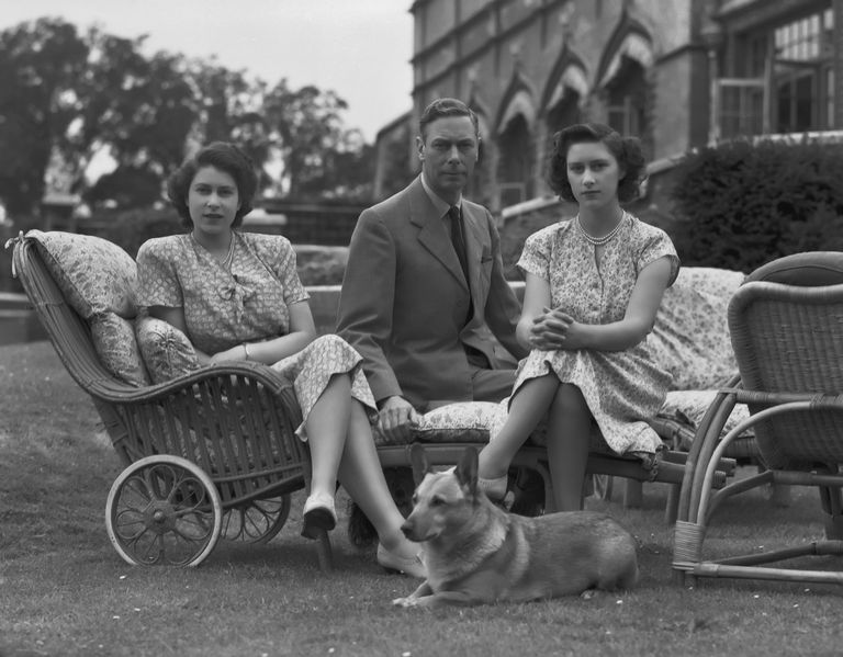 Royal family portrait with a corgi