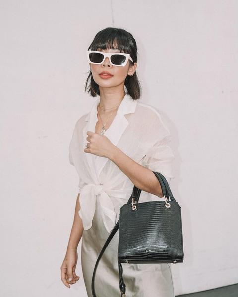 Rhea Bue with big pair of sunglasses