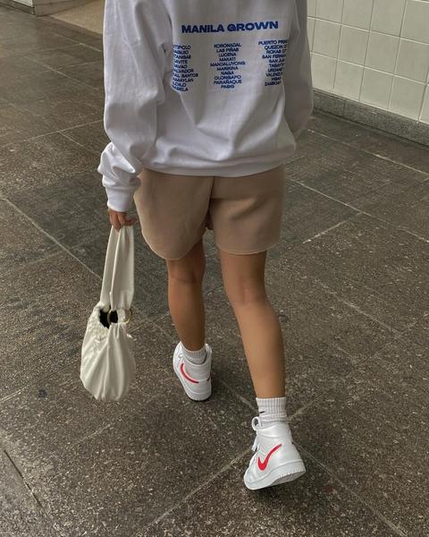 Rhea Bue walk away from the camera