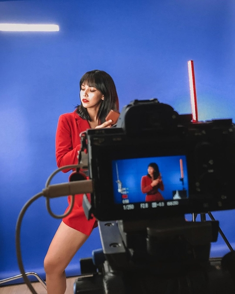 Patricia Prieto wearing a red top with red lipstick