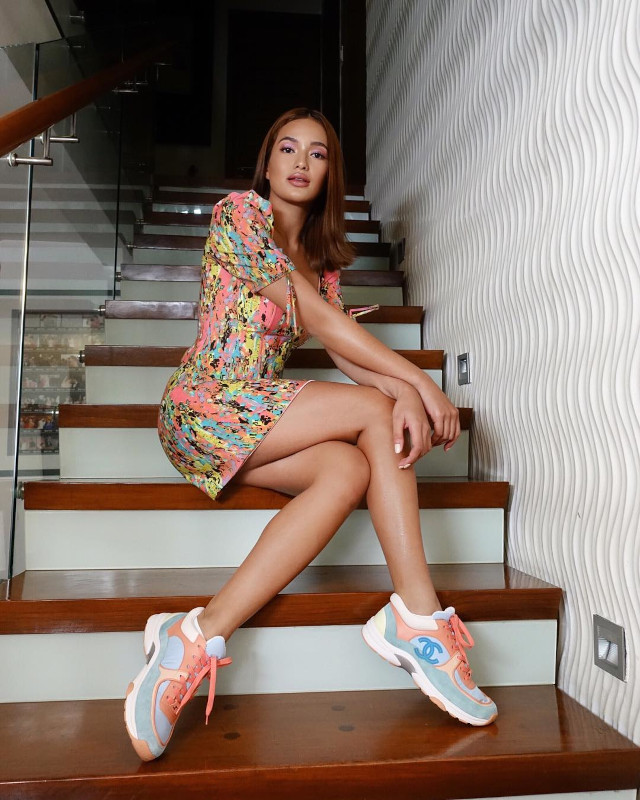 Home Photo Shoot Idea: Sarah Lahbati wearing a floral dress and colorful sneakers.