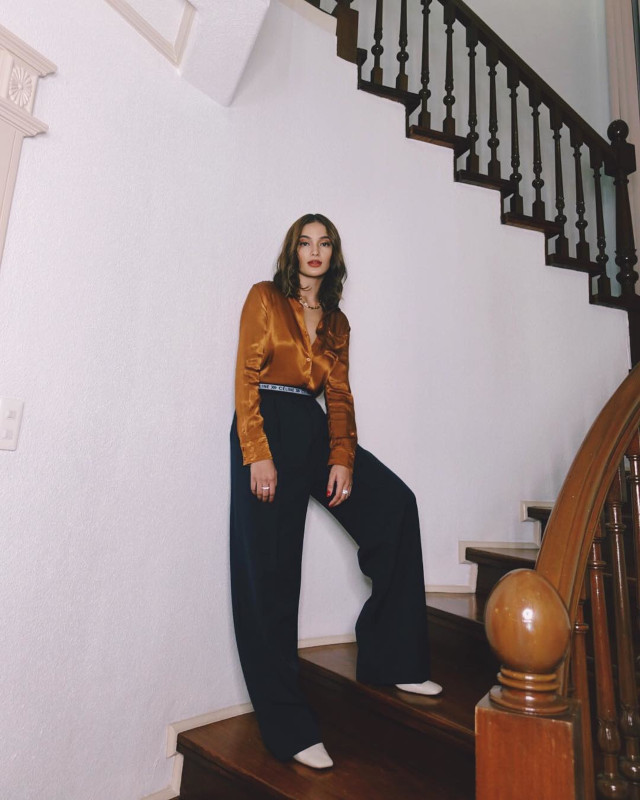 Home Photo Shoot Idea: Sarah Lahbati standing on the stairs.