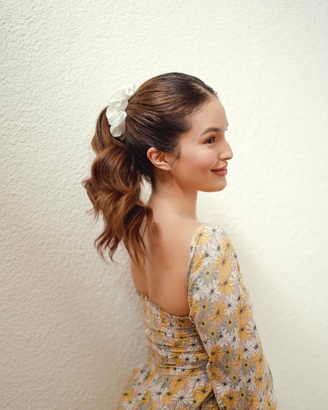 Home Photo Shoot Idea: Sarah Lahbati wearing a floral dress.