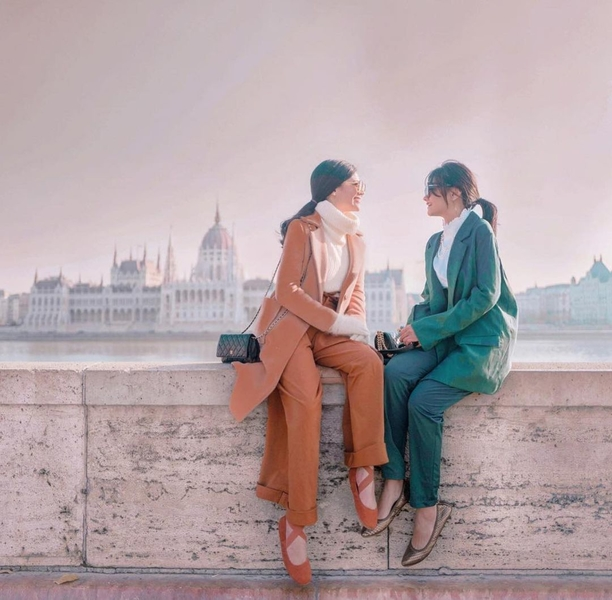 Vern and Verniece Enciso wearing different solid-colored coat and trousers