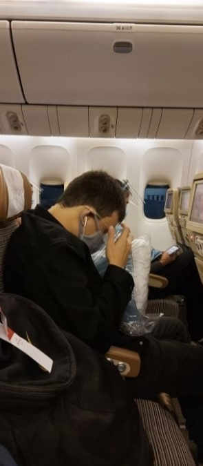 Travel in the new normal: Dana's boyfriend, sitting two seats apart from her in the plane