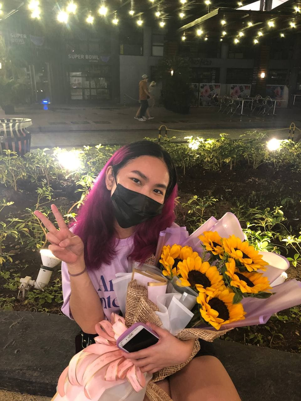 Dating during a pandemic: Cheska with a bouquet of sunflowers