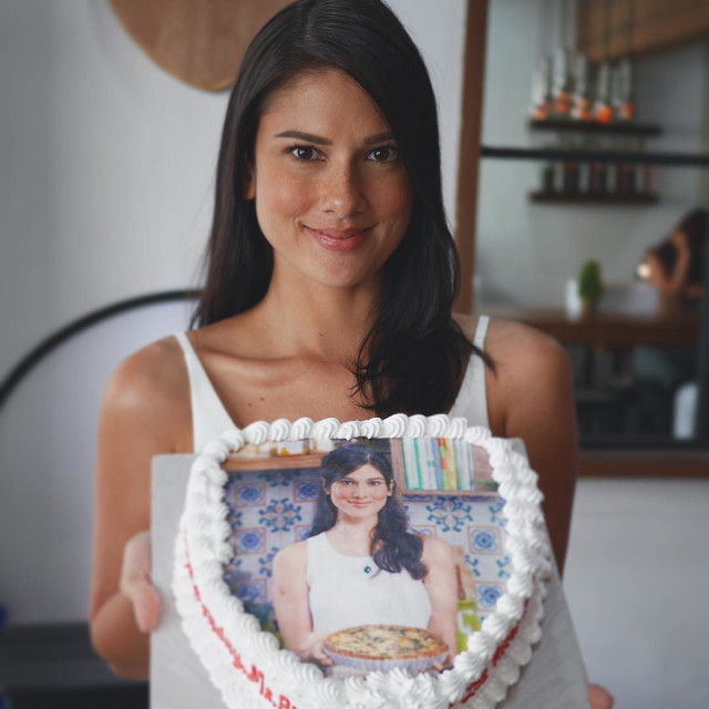 Bianca King holding a cake.