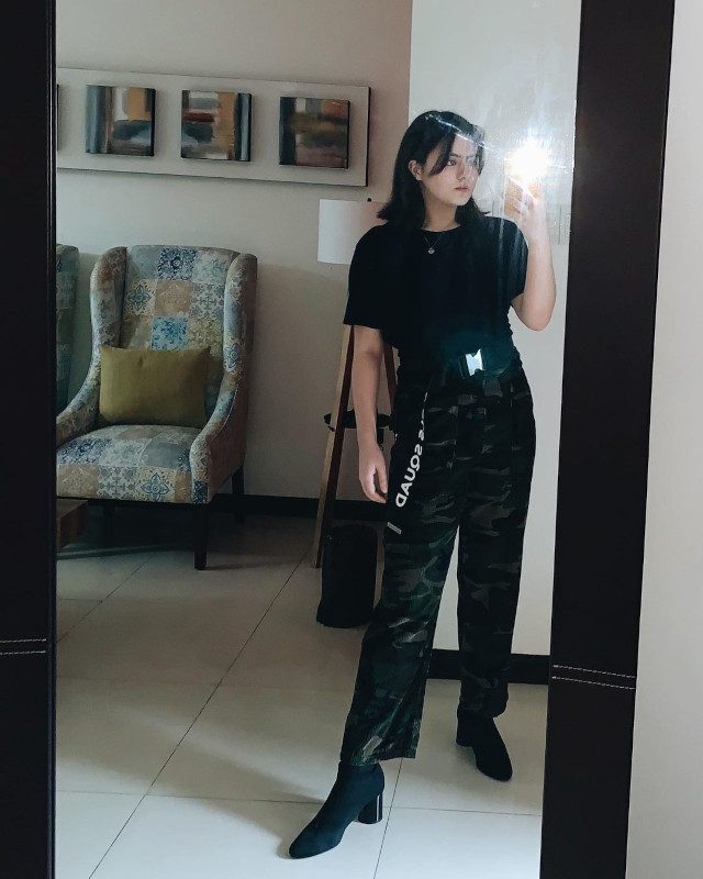Cassy Legaspi wearing black t-shirt and camouflage pants.