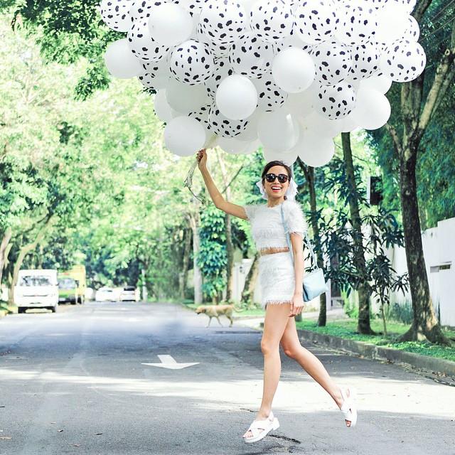 Martine Cajucom holding balloons.