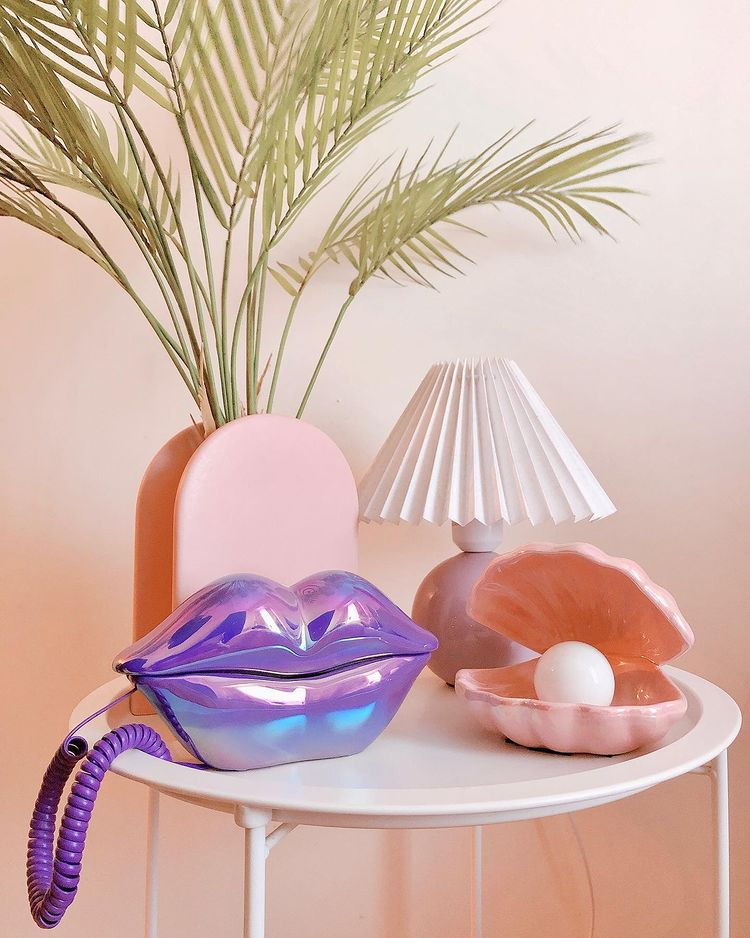 Cool telephone from Rotten Mermaid Studio: holographic purple