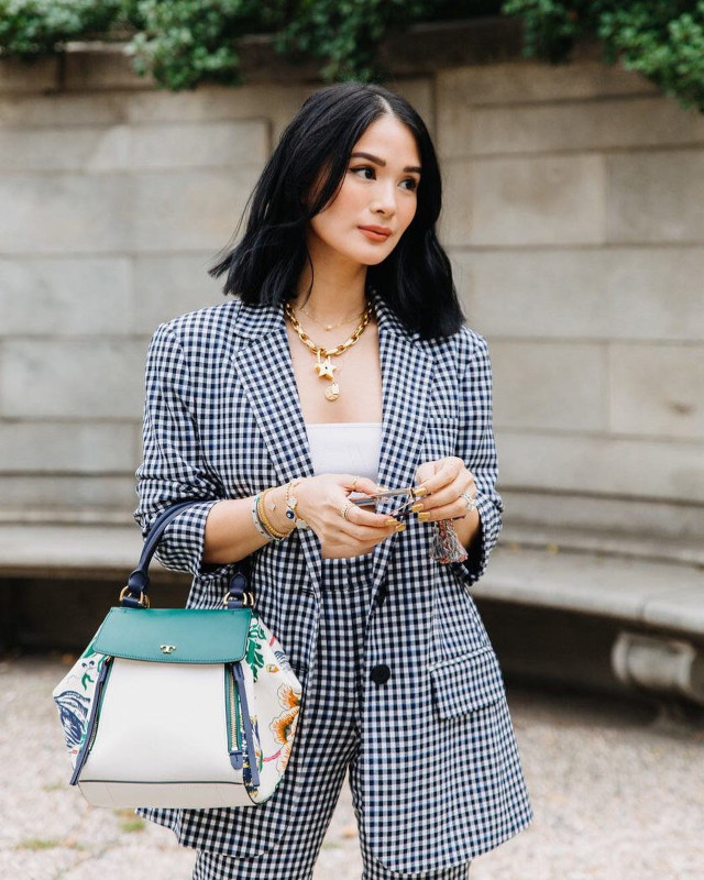 Heart Evangelista wearing gingham suit and bralette.