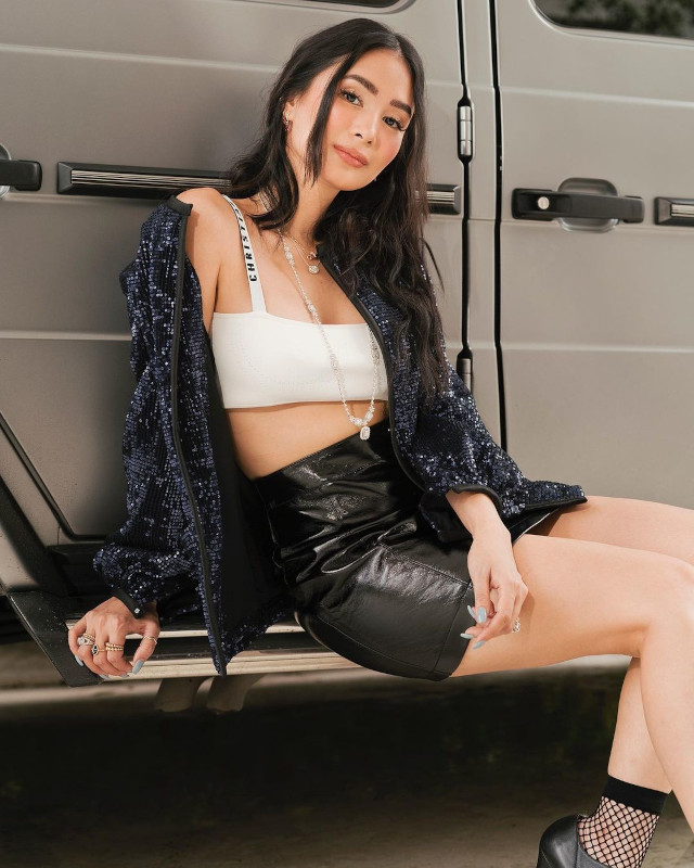 Heart Evangelista wearing jacket, bralette, and leather skirt.