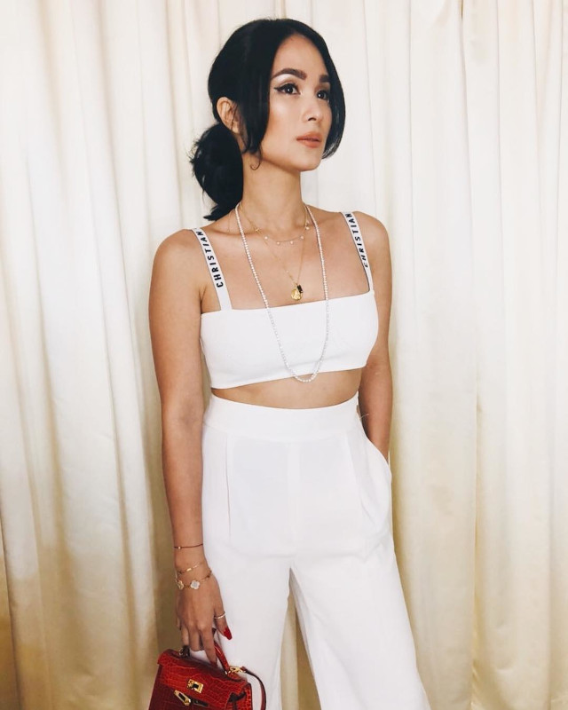 Heart Evangelista wearing white Dior bralette and high waist trousers.