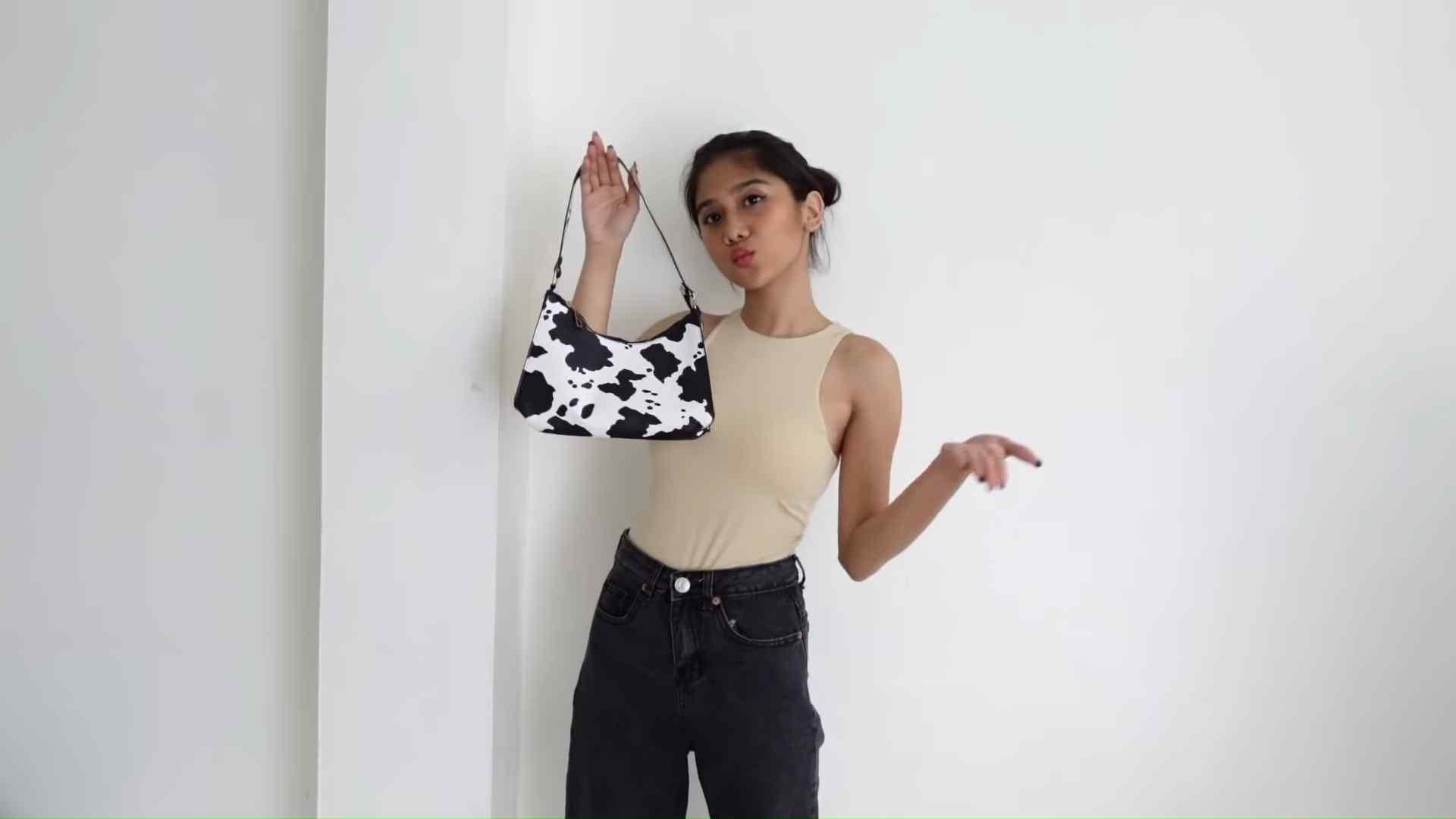 Ashley Garcia's Bag Haul - a bag with cow print