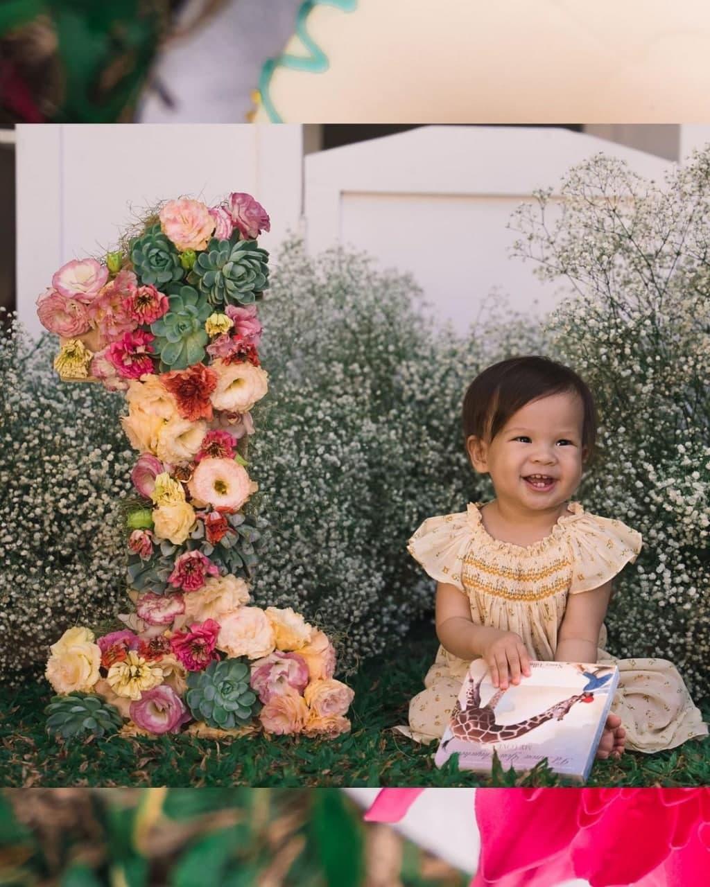 Dahlia Amélie in her floral themed birthday