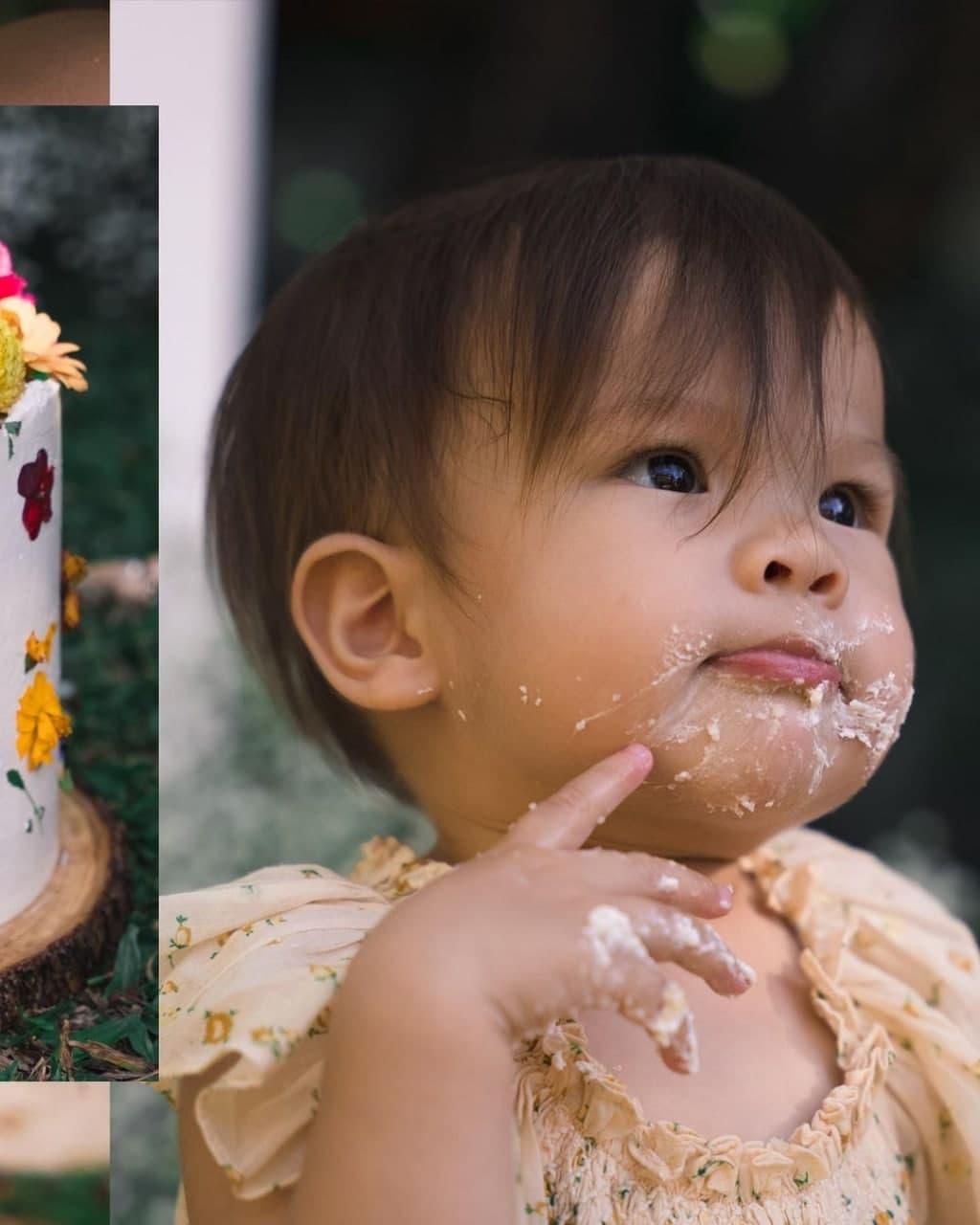 Dahlia Amélie with her cake