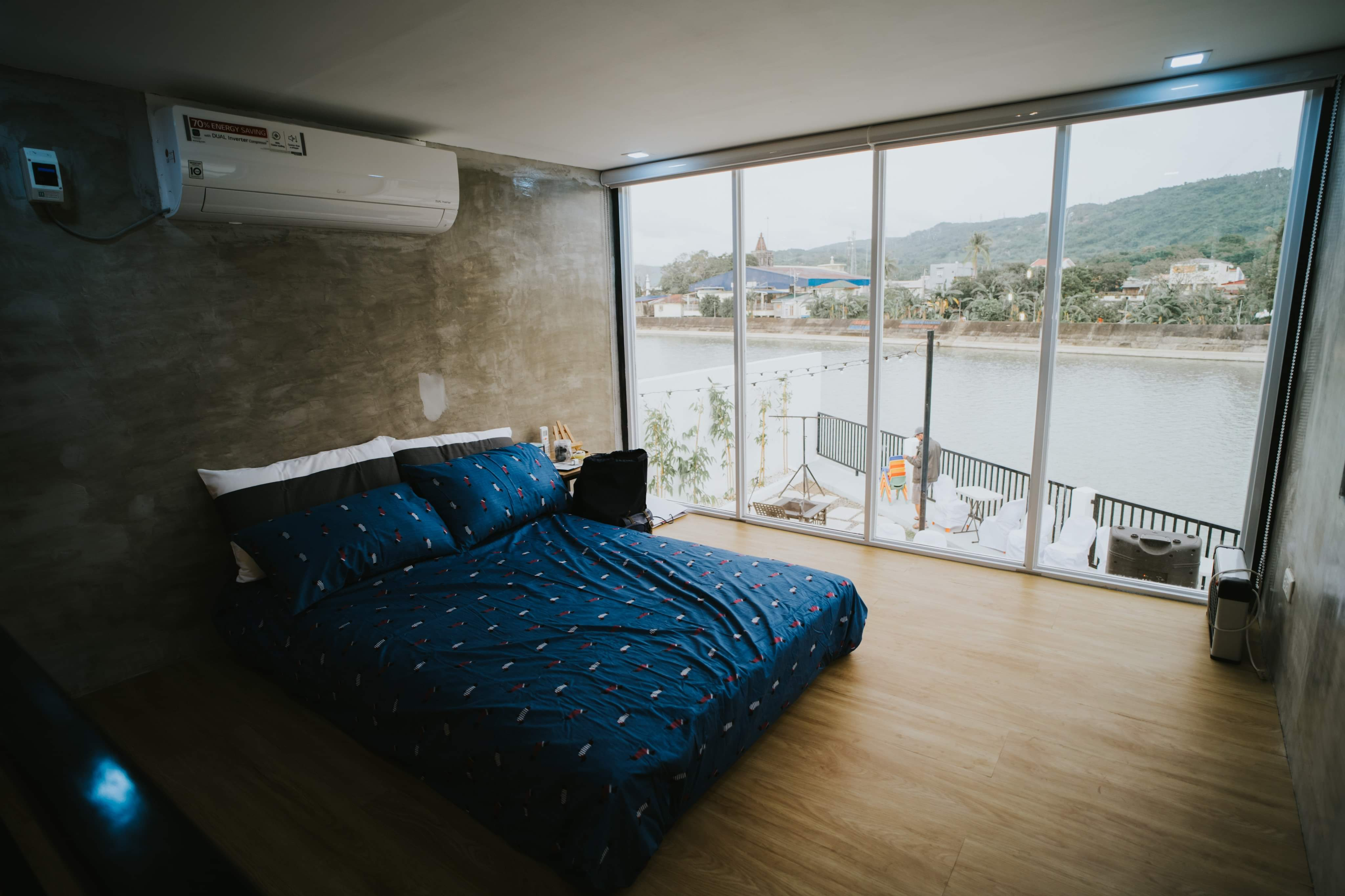 Wide open windows inside the bedroom - container house interior