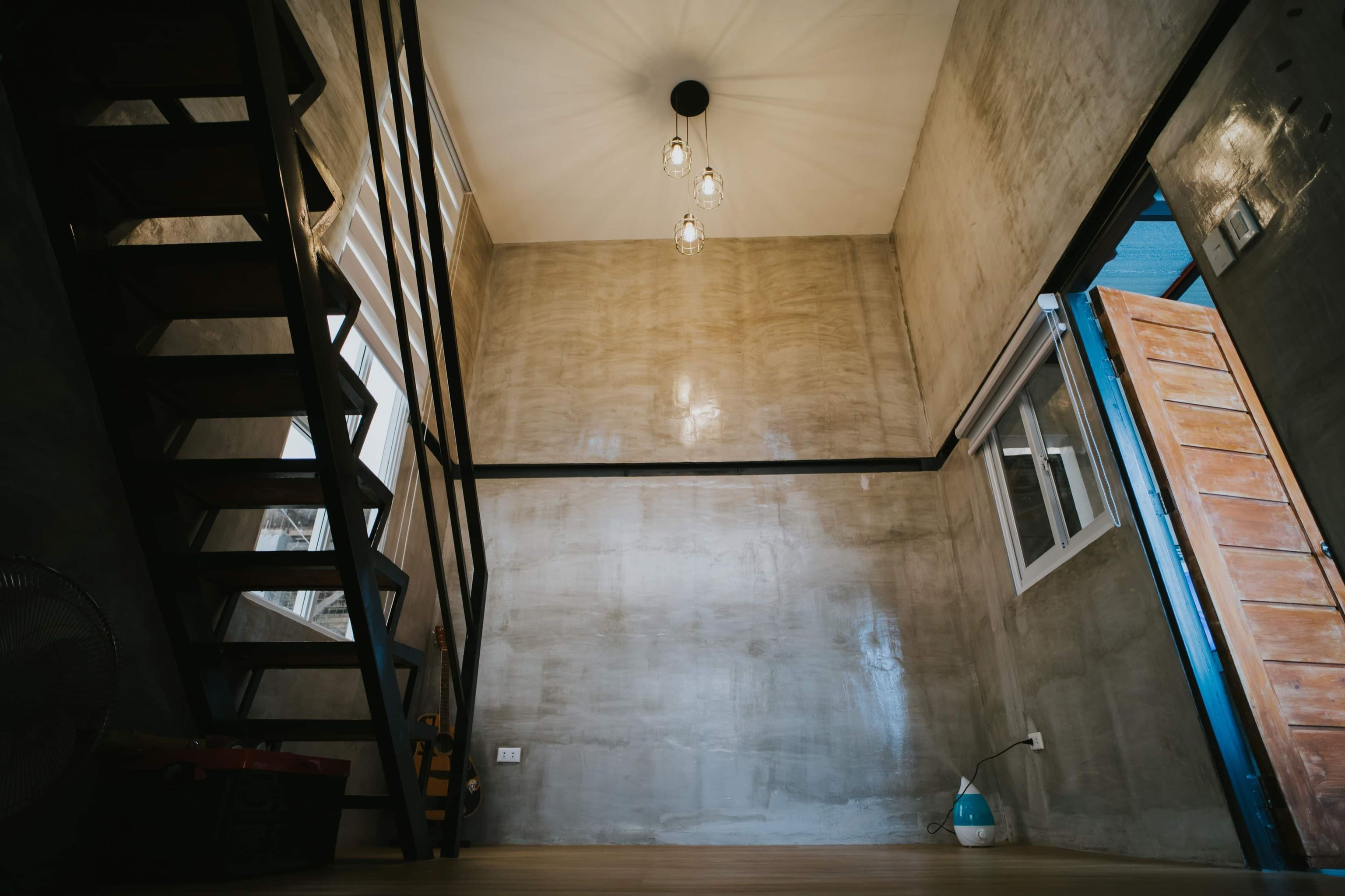 Tiny house: warm lights, stairs, and ceiling