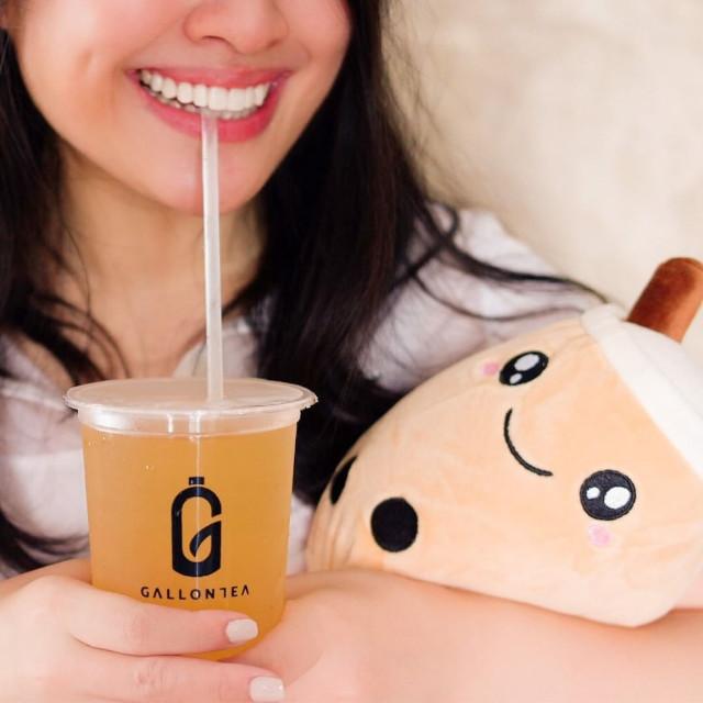 Girl hugging milk tea stuffed toy
