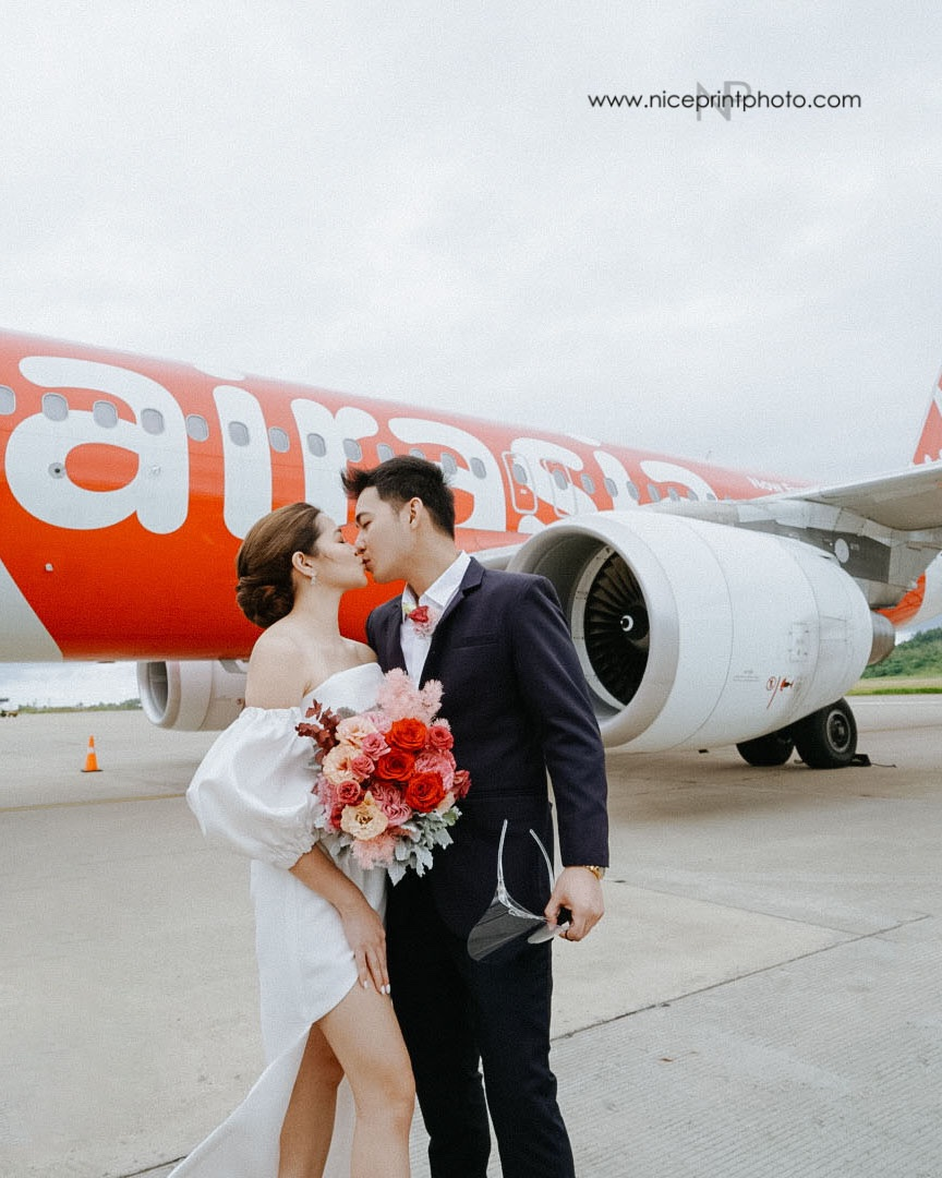 wedding of two flight attendants during a commercial flight: outside aircraft