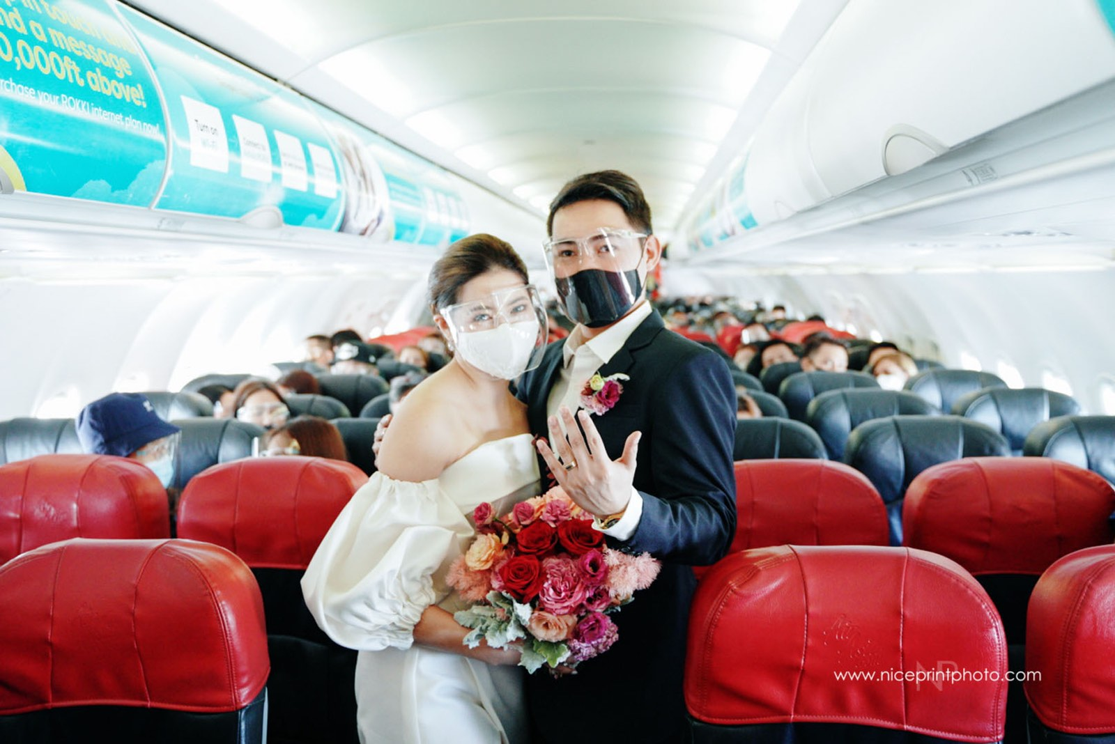 wedding of two flight attendants during a commercial flight: married couple