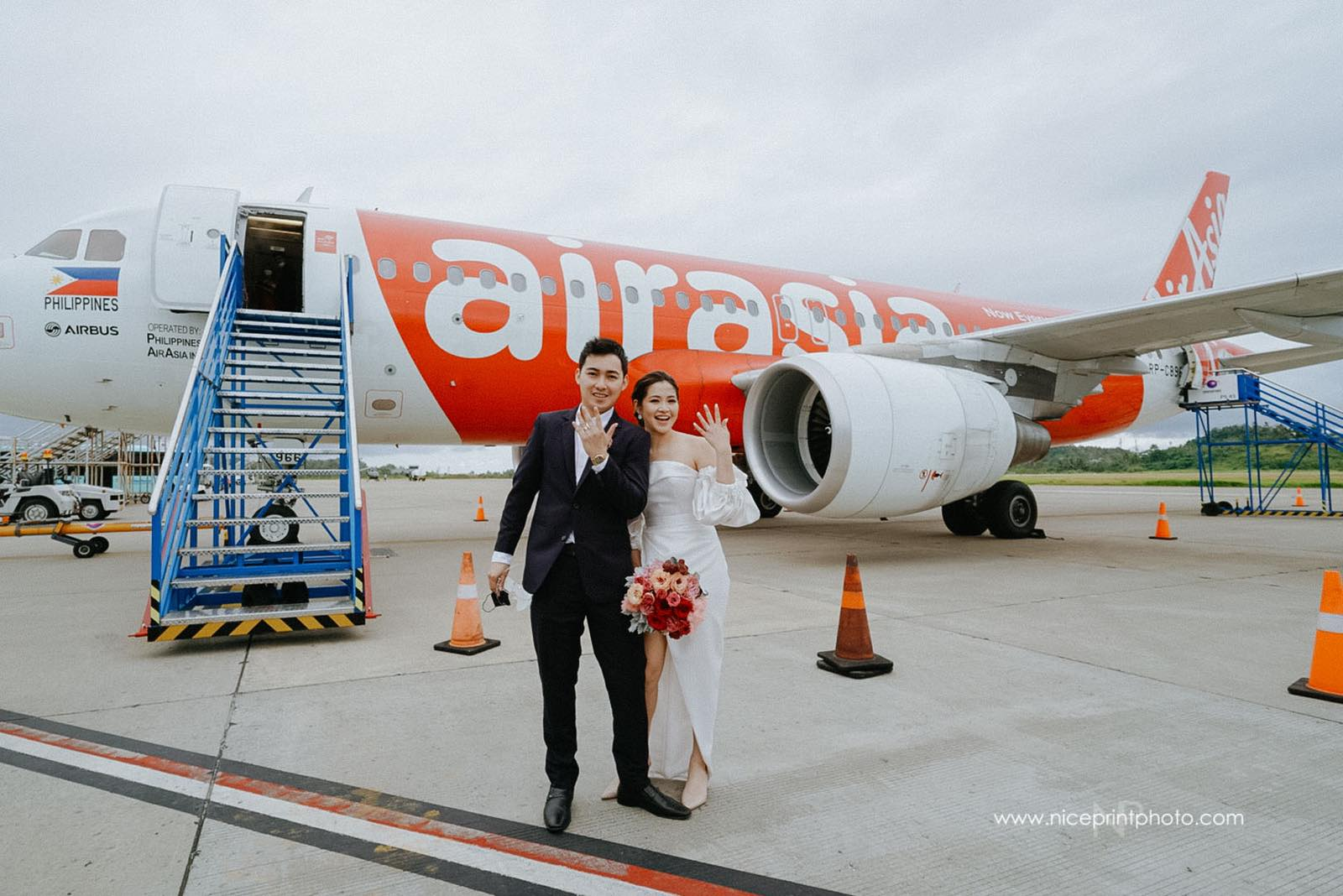 wedding of two flight attendants during a commercial flight: bride and groom outside aircraft