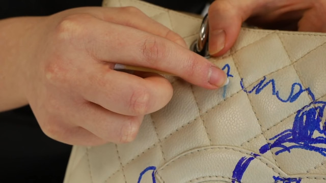Chanel bag restoration: Remove ink with special cleaner
