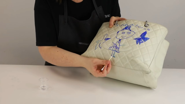 Chanel bag restoration: Spot-removal of ink stain