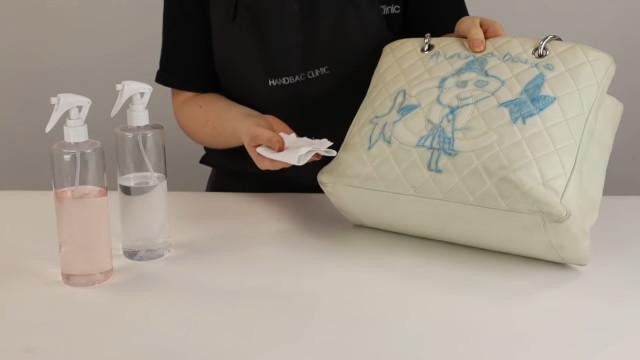 Chanel bag restoration: Wipe off leftover ink stain