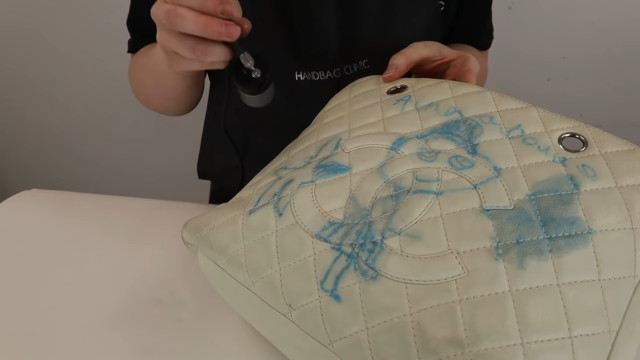 Chanel bag restoration: Spray with metallic coating for extra protection