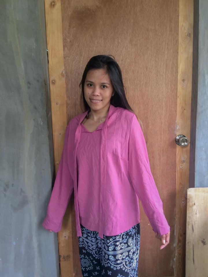 A pink longsleeve shirt before modifications