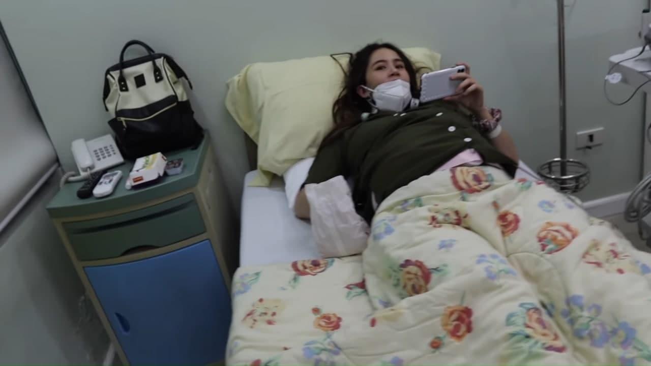 Sophie Albert eating fries on her hospital bed